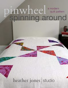 Over sized pin wheel quilt olive and ollie; would be great for bright Kaffe Fassett fabric and at least part of what is shown is Kaffe.
