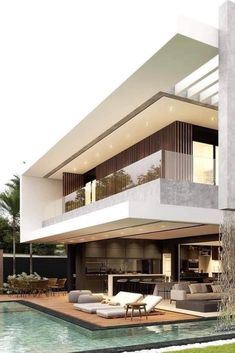 the modern exterior design of the perfect dream house with skylight and swimming pool decorations inspires your happiness Modern Architecture House, Architecture Design, Modern Houses, Architecture Sketchbook, Modern Exterior, Exterior Design, Modern Villa Design, Contemporary Home Design, Modern Contemporary Homes