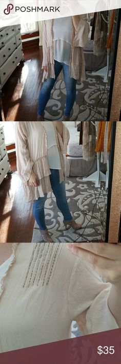 "Boho Ruffled Cover-up Nwot. From Joyfolie. Mia joy brand. Very feminine and romantic. It is one size fits most.  Cream color gauzy fabric with beaded shoulder and around collar in back. I'm 5'4"". It hits just behind knee in back and mid thigh in front. Wide sleeves but not dolman. Thanks for LOOKING! All pieces in photo are for sale in my closet😍😘except shoes. Mia Joy Other"