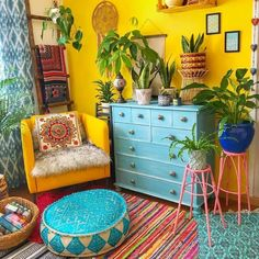 In this design idea for your home interior, the overall use of the yellow theme is creating some sense of attraction for the onlookers. The tetrapod stands with the plant pots of nice colors, the nice looking chair, cushions, and the rug, everything seems to be perfect and urging a desire for you to adopt such a makeover.