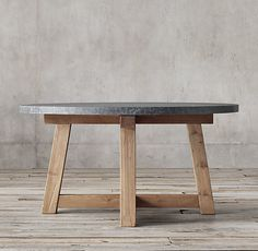 """RH's Salvaged Wood & Marble Beam Round Dining Table:Our table pairs a 2""""-thick marble top with the natural beauty of solid salvaged pine timbers from 100-year old European buildings."""