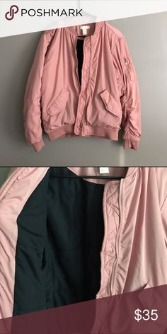 Pink Bomber Adorable pink bomber! The inside is lined with a navy blue and the hardware is made to look like silver and gold so it's perfect for any outfit! Never been worn, just bought. H&M Jackets & Coats