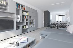 Rénovation d'un appartement contemporain à lyon avec un meuble central sur mesure. 3d du salon