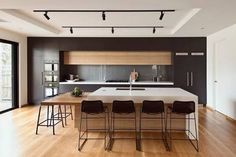Image result for black kitchen with timber floors