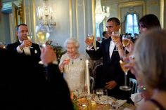 President Barack Obama offers a toast to Queen Elizabeth II during a dinner held in the Queens honor at Winfield House in London, England, May 25, 2011. Actor Tom Hanks is pictured at left.