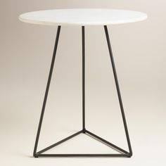 Handcrafted by skilled Indian artisans, our versatile side table features a natural marble top in alabaster white with gray undertones and subtle gold flecking. A black triangle base provides intriguing contrast for a look that's equally modern and industrial.
