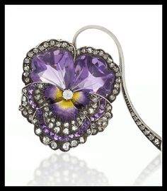 Amethyst, diamond, enamel (purple and yellow pansy centre), 18k gold and silver pansy brooch; French, circa 1880.