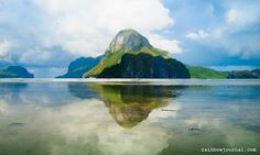 Paradise on Earth.  The town of El Nido is small and can be easily covered on foot. The people are as beautiful as the islands that dot the bay.  Pictured is the iconic Cadlao Island.  Read more at rainbowjournal.com  #travel #elnido #palawan #philippines #itsmorefuninthephilippines #paradise Paradise On Earth, Hotel Reservations, Palawan, Philippines, The Good Place, Islands, Adventure, Canning, Places