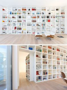 When it s closed this secret door blends in completely with the other shelving units in this large wall of white bookshelves Hidden Door Bookcase, White Bookshelves, Bookcase Wall, White Shelves, Hidden Doors In Walls, Bookcases, Loft Conversion Design, Home Library Design, Hidden Rooms