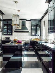 black white kitchen. subway tile backsplash. large island pendant light. large checkered floor Steven Gambrel design