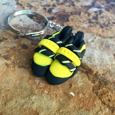 A truly one-of-a-kind item for rock climbers. We can (and will) match any climbing shoe... just ask. One custom made rock climbing shoe keychain with colors and patterns inspired by your shoes. All keychains are handmade from durable and color-fast polymer clay. No two are exactly alike.