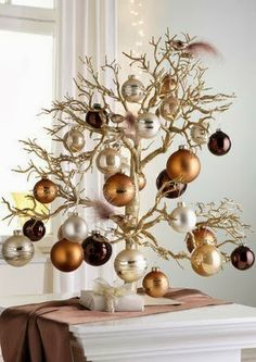 "Small Christmas Tree - Love this idea for my apartment, especially since the ""tree"" is gold. Now to look for a suitable branch..."