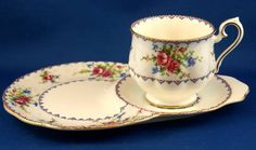 Royal Albert Petit Point Hostess Tennis SET. I like this one not so much for the shape but because it reminds me of my enjoyment of cross stitch.