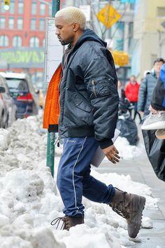 Kanye West wearing  Raf Simons 2005 Curriculum Anniversary Bomber Jacket, Gosha Rubchinskiy Printed Track Pants, Yeezy 950 Boots