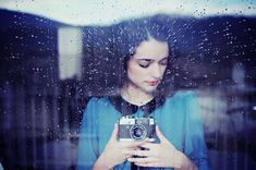 selfies with your camera..lol I like the colors and how soft her skin looks here, well everything for that mater and the rain drops do a good job of acting texture.  : )