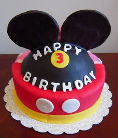 A funny single layered Mickey Mouse cake.