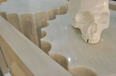DAVIDOV PARTNERS G-LUX SHOWROOM PLINTH DETAIL. Skull. Limed pine wood timber structure.