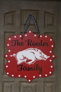 Offically Licensed Collegiate Custom Arkansas Razorback Door Hanger. $39.00, via Etsy.