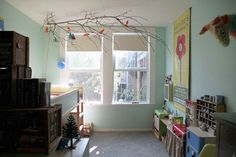 so whimsical... I love this hanging tree branch with birds in it for a kids bedroom