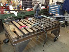 Beefy welding table made of scavenged I beams (well, H-beams or something). Looks awesome for clamping. Sorry, its a table - WeldingWeb™ - Welding forum for pros and enthusiasts