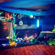 Prom Theme. DIY Under the Sea Décor: card board & paint become fish and other sea creatures, clear balloons hung from fishing line become air bubbles, 260 balloons become coral, add tulle and deco mesh in various shades of turquoise & blue and a few LED lights. Magical! :)