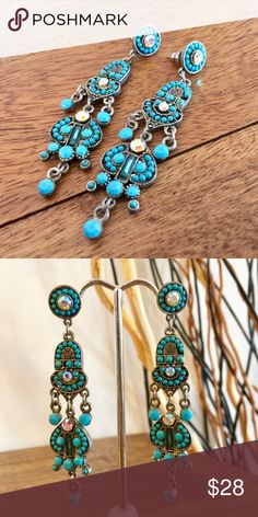 """Faceted Glass Earrings in Turquoise and Crystal. These are so pretty and can be worn to a cocktail part or with jeans. They are made with all silver toned findings. All faceted class inlay and set on a lead free ear wire. They are 2 3/4"""" from the top of the list to the bottom. The Painted Jezebel Designs Jewelry Earrings"""