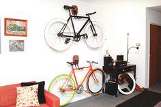 DIY: http://www.minipennyblog.com/2011/03/custom-diy-bike-storage.html