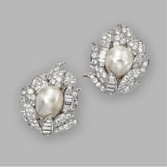 Pair of baroque cultured pearl and diamond earclips, David Webb. Baroque cultured pearls measuring approximately 15.9 by 12.6 mm. and 15.2 by 12.8 mm., baguette and round diamonds weighing approximately 9.85 carats, mounted in platinum, signed Webb.
