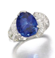 SAPPHIRE AND DIAMOND RING Set with a pear-shaped sapphire weighing 5.72 carats, between radiating shoulders of baguette diamonds