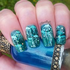 Layers of stamping alternated with sheer and glitter polish, stamped with Moyou sailor plates. - Nailpolis: Museum of Nail Art