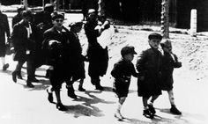 Jewish children walk to a holding camp as part of the Vel d'Hiv roundup in Paris, 1942. Many were later transferred to Auschwitz. Photograph: Antoine Gyori/Sygma/Corbis