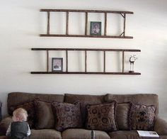 Vintage wood ladder wall decoration over couch.  So many people find ladders in the trash.  I had to pay $50 for the one that I will use to copy this idea.