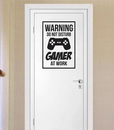 """Warning Do Not Disturb Gamer at WorkThe latest in home decorating. Beautiful wall vinyl decals, that are simple to apply, are a great accent piece for any room, come in an array of colors, and are a cheap alternative to a custom paint job. Default color is blackMEASUREMENTS: 24"""" x 16 1/2""""  About Our Wall Decals: * Each decal is made of high quality, self-adhesive and waterproof vinyl.* Our vinyl is rated to last 7 years outdoors and even longer indoors.* Decals can be applied to any clean…"""