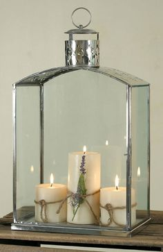 Mantelpiece Lantern - Polished Stainless Steel. Can't you imagine this on your fireplace mantle this fall & winter?