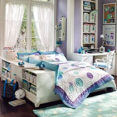 purple and teal, another great color combination. Love the polka dot rug, great storage, national and pretty.