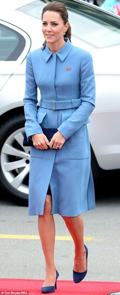 10 April 2014 - Kate was radiant in a a military blue Alexander McQueen coat with her hair swept back in a ponytail. She clutched a navy blue purse and wore suede pumps in the same hue