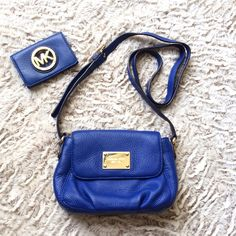 Michael Kors Flap Back Crossbody & Sm Wallet 100% authentic Michael Kors Flap Back Crossbody AND small credit card holder/wallet included!!. This gorgeous crossbody is a bright royal blue color. It was carried less than five times. The interior has some stains from carrying makeup (please see photos). The outer leather is in near perfect condition. The gold MK plaque on the front has a few VERY light dusting scratches that are barely visible. This is a perfect pop of color for spring/summer…