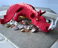 """""""My armor is like tenfold shields, my teeth are swords, my claws spears, the shock of my tail a thunderbolt, my wings a hurricane, and my breath death!""""   Check out this awesome Smaug amigurumi pattern from Instructables!"""