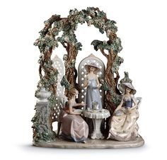 Lladro Porcelain Figurine Tea in the Garden - 23 1/2 inches high x 20 1/2 inches wide. Limited edition of 2000. Base Included. - Price $12,000.00
