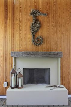 Outdoor fireplace with driftwood seahorse sculpture.  Browse Driftwood Decor on Completely Coastal: http://www.completely-coastal.com/search/label/Driftwood%20Decor