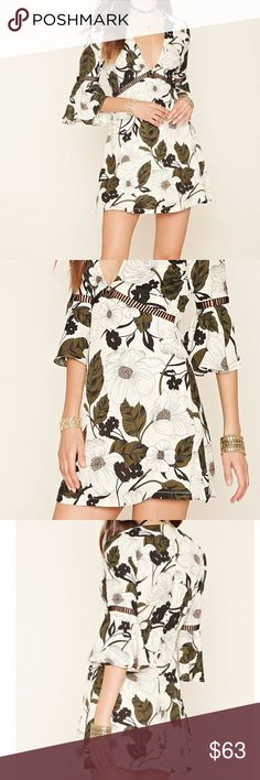 Rare London Jungle Cutout Mini Dress Pretty floral dress with cutout details perfect to pair with a choker sizes XS-S YES to: Bundle Discounts NO to: Trades / Modeling / Holds  Happy Poshing!!  ASOS Dresses Mini