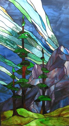 Northern Lights shimmer in the night sky! This beautiful Northern Lights window was crafted by Peter Galway at Breslau Art Glass.   The blues, greens and dashes of yellow shimmer across the navy night sky and light up the mountains and valley below.   This panel measures 24″ X 36″ . Design by Glassmith Studios. Created at www.breslauartglass.ca