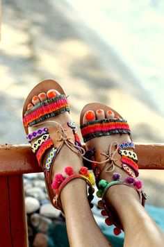 Pom pom sandals are the perfect summer holiday shoe. Wear to the beach or to dinner in the evenings.