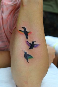 love this idea of mixing black & color for a hummingbird tattoo.