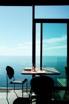 mondrian glass wall table wine drinking leisure luxurious simple enjoying life sea water ocean blue sky blue chair Peggy Wong photo photograph by Peggy Wong