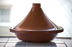 The tagine--sometimes spelled tajine--is the traditional clay cooking pot used by North African cooks to conjure up deliciously spiced, slow-cooked stews and braises. It can be used to make both tender meat dishes and fragrant vegetable concoctions. Moroccan Tagine Recipes, Moroccan Dishes, Morrocan Food, Easy Cooking, Cooking Tips, Cooking Recipes, Cooking Bacon, Cooking Games, Cooking Light