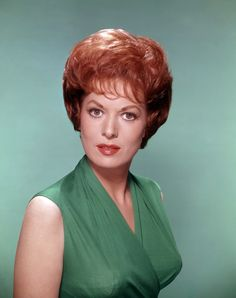Maureen O'Hara. B.1920. Active 1938-2000. Beautiful red-headed Irish actress usually played strong independent women, and she worked in several great movies with John Wayne or directed by John Ford. She was also a singer and actually took over and ran an airline when her husband was killed in a crash in 1978. A wonderful actress who has given us pleasure for over 60 years.