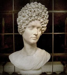 Ancient Rome- Flavian marble sculpture- showing elaborate woman's hairstyle