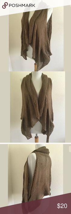 Buzz flowy vest SKU: SD14129  Length Shoulder To Hem: 26 Fabric Content: 100% Acrylic Buzz Tops