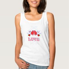"Flourishes, swallows, red love hearts and roses compete with the word ""LOVE"" make up this fabulous tattoo inspired design in tones of red and blue which just pop on the black base. A great fashion top and a lovely romantic gift idea for someone special."